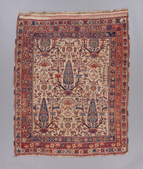 """Afshar with a cypress tree deisgn. Beautiful white ground example of its type. In good condition with some wear. Cotton wefts.  4'11"""" x 4'2"""".    Please visit our website for more rare  ..."""