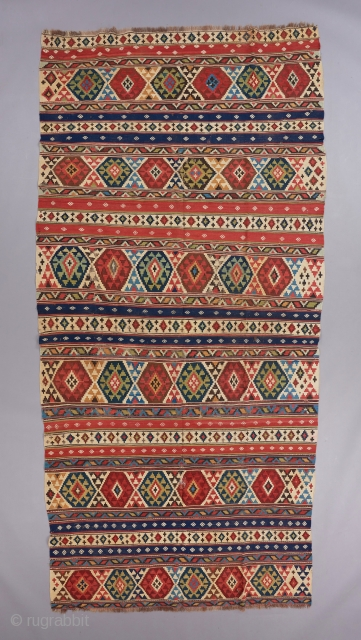 "Caucasian Kilim. Superb color, a great and old one of its type. It has some embroidered little motifs in the blue and red stripes. 11' x 5'4"". Wear and tear. 