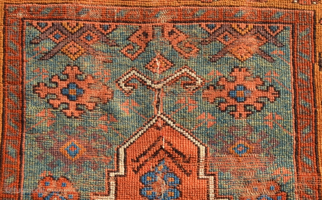 Turkish prayer rug. The middle of the field has been re-stitched together.