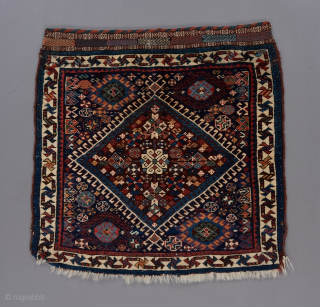 """Qashqai dazzler. Great juxtaposition of the spacious border with the dazzling field motifs. This weaver was strutting her stuff. 2'1"""" x 2."""