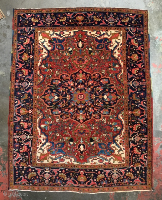 Antique Persian Heriz rug in a difficult to find size. Superb all natural dyes. Size: 5'1 x 6'5 Age: 1920 Condition: Excellent condition with medium to low pile glossy handspun wool. Will  ...