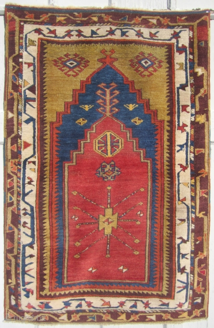 An Anatolian carpet from the Konya region. Woven in the last quarter of the 19th century. Exquisite colors, full pile and an overall masterpiece to gaze upon. It measures to 4ft 2in  ...
