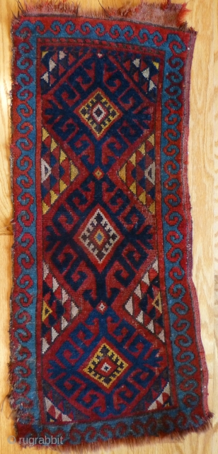 Uzbek Napramach cradle rug. 34 x 14 inches. Mostly medium to low pile. A few knots worn down. Minor edge and end loss. See www.banjaratextiles.com for more rugs and textiles.