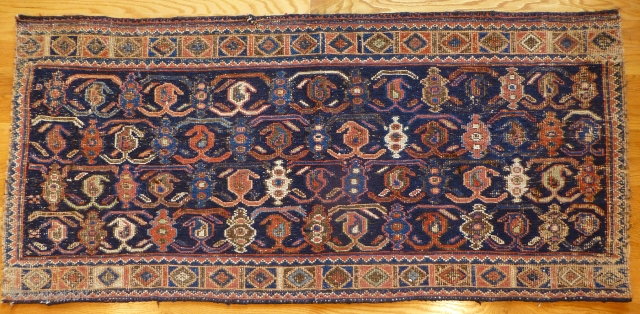 Afshar flatweave. 50 x 23 inches. Some wear. Somewhat coarse weave. Attractive design.