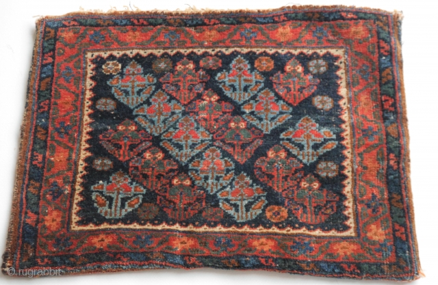 small Veramin bag with flowers, Northwest Persia with wonderful natural colours,green and light blue. Good condition, the kilim backside doesn't form one part with the front, but I am almost certain it  ...