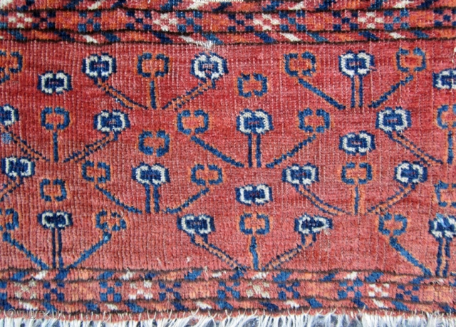 Very unusual Turkmen fragment. probably the skirt from a Tekke Engsi. The centers of most of the elements are magenta silk. One of a kind.