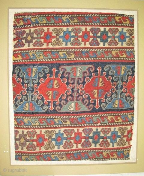 Sumak Mafrash Panel, mounted in a frame.