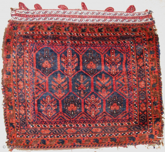 """Timuri type Baluch Bagface, exceptionally lustrous wool, great soft shine, complete fasteners preserved on top along with floating weft ends. Very sweet piece. 21""""x24"""""""