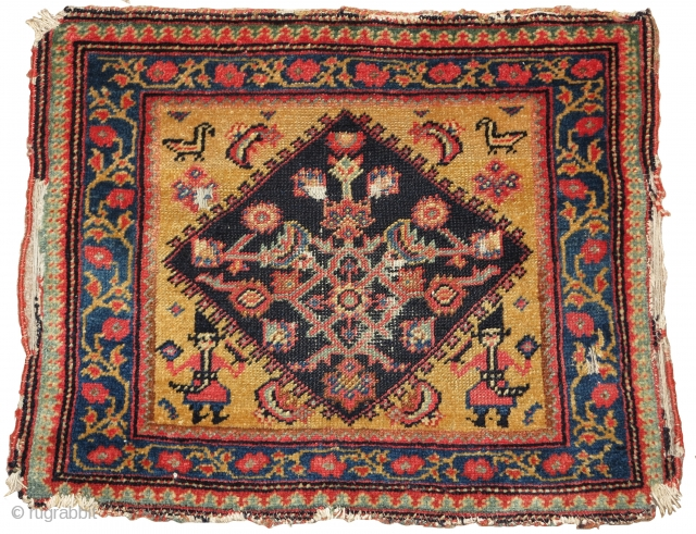 "Interesting Senneh or related west Persian bagface with Qajar soldiers bearing swords and birds in the corners, nice wool and saturated natural colors including a great yellow ground. apx. 26""x 20"""