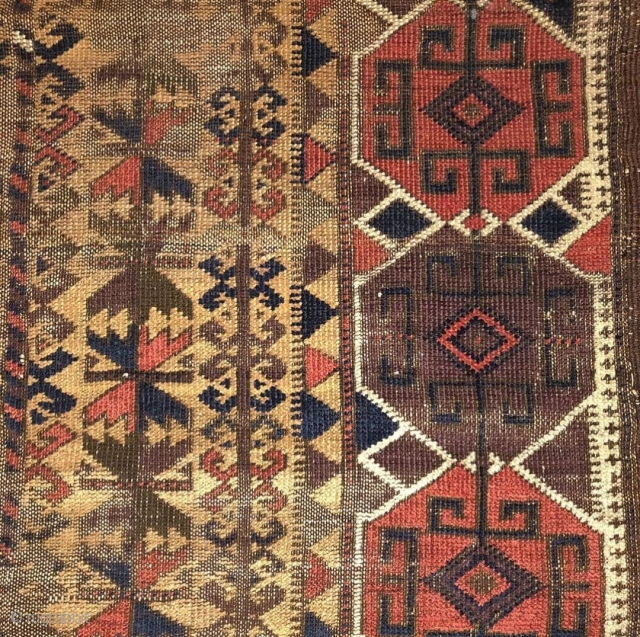 """camel ground Baluch rug. Intriguing design with a border inspired by Shahsevan sumaks. Finely woven but with corrosive browns and obvious wear. Flat back and 4 chord goat selvedge. 2'9""""x4'2"""" Ask about this"""