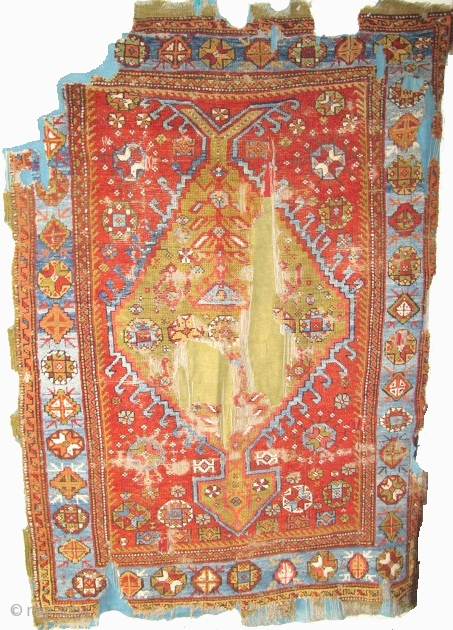 Western Anatolian Medallion Rug, great color and organic asymmetry, mounted and conserved.