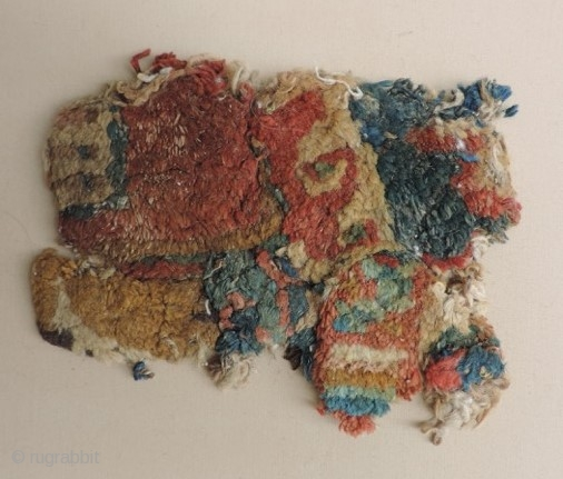 Ancient Carpet Fragment, 3rd - 6th century. a similar fragment from perhaps the same rug is in the Al-Sabah Collection, Kuwait along with other related early knotted pile carpet fragments. It is  ...