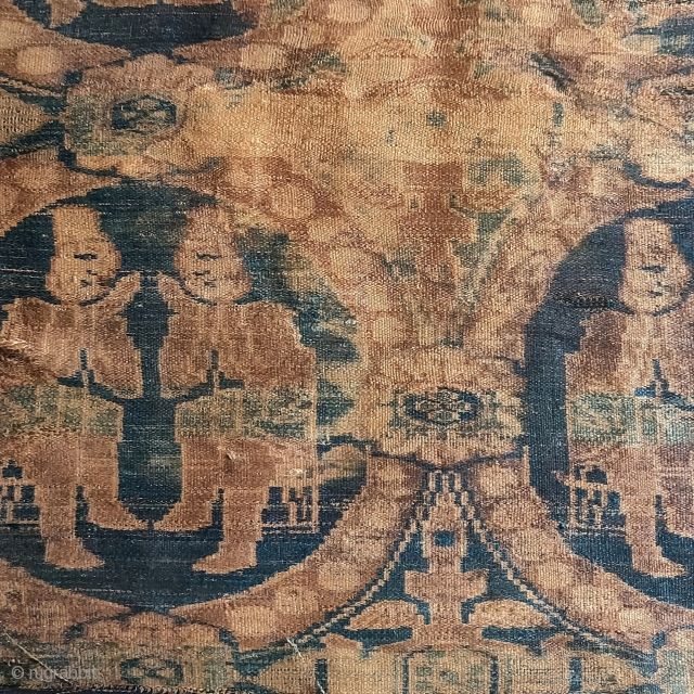 6th- 7th century silk warp-faced textile fragment in the 'International Style' depicting seated Central Asian or Iranian merchants within roundels ornamented with pearls.   This warp-faced structure pre-dates the weft-faced samite silks  ...