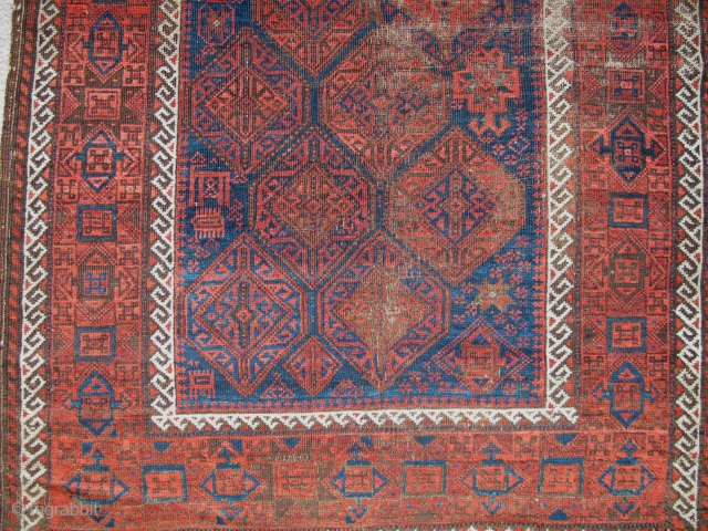 "Baluch Rug with hexagonal field pattern. Very soft and pliable blanket-like handle. poly-chromatic blue and open drawing with an abstracted animal, various stars, and assorted ja-bips 3'x5'9"". A former Basha piece."