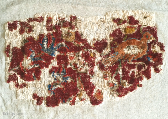 small mounted fragment of a Northeast Persian Khorosan carpet. The bird seen on this piece is reminiscent of those seen on a much larger Northeast Persian 'Portuguese' carpet fragment sold as lot  ...