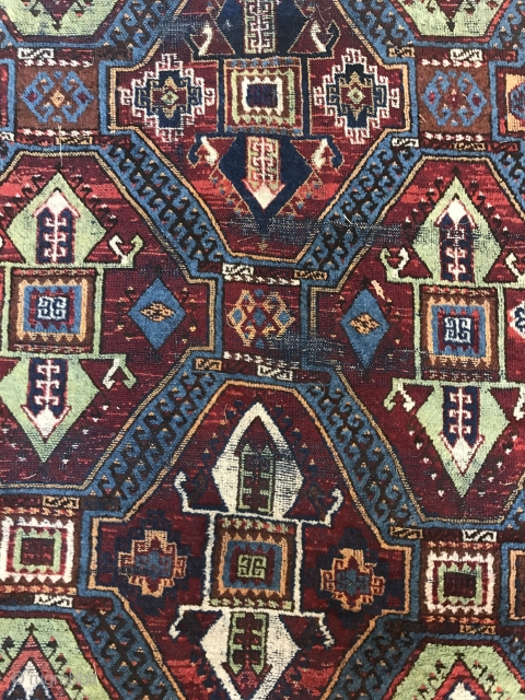 Kurdish rug, iconic design. Worn but classic. Not super old, but an authentic tribal piece.