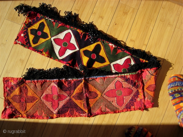 Uzbek Suzani border fragment.  55 inches long, 7 inches wide.  Pieced and sewn, 4 inches, 12, 10 and 30 inches. Fringe 2 inches.  Tight bright embroidery.