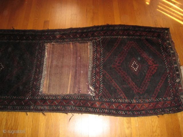 Baluch saddle bags, wool pile fronts, flat weave wool back.  Pile border extends between the two bags.  30 inches by 76 inches overall.