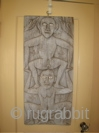 Carved granary door from Kalimantan (Borneo).  Incised carving of human figures with bone inserts for eyes.  15 inches wide by 34 inches high.  1 inch thick.