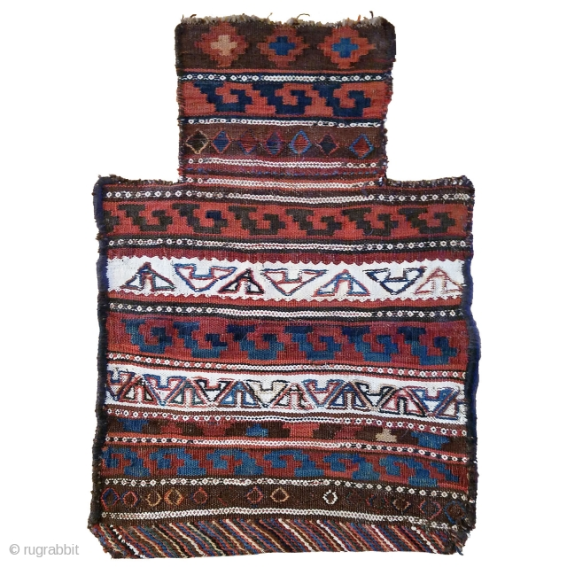 Persian tribal salt bag -- Features multiple flatweave techniques and great graphic punch. The blue, brown and ivory palette is set off nicely by the multi-color diagonally striped reinforcing twill weave on  ...