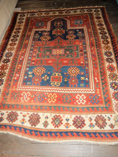 ALMOST A ROOM SIZE ANTIQUE FACHRALO KAZAK PRAYER RUG- WITH A SIZE OF 66 X 90 INCHES- 