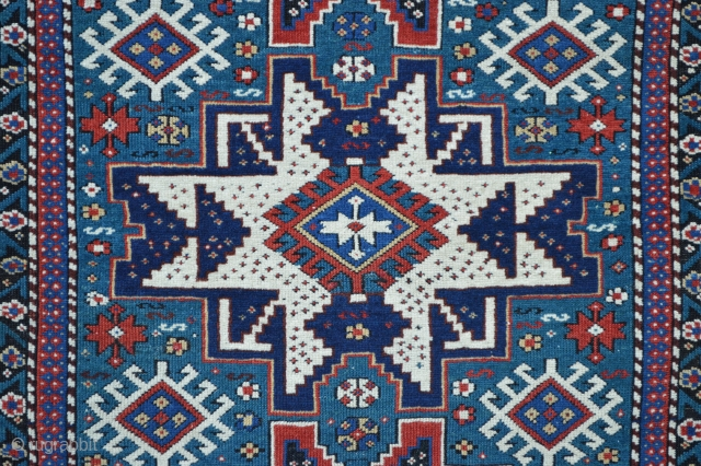 "Antique east Caucasian Lesghi rug with aqua-marine field (not blue) in good overall condition 1.42m x 1.04m (4' 8"" x 3' 5"")."