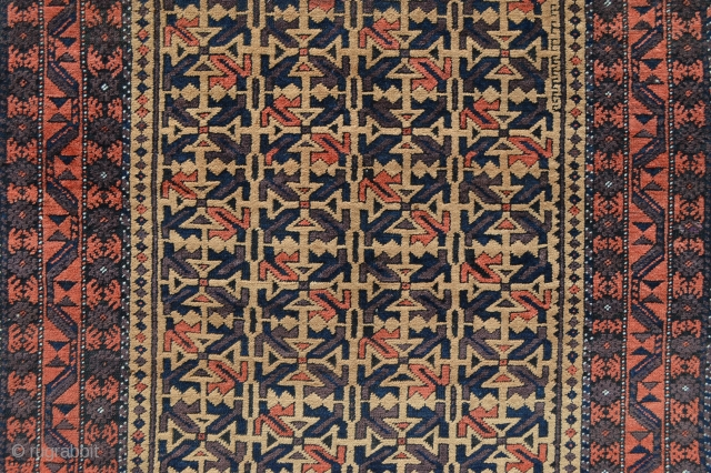 "Camel-field Khorassan Baluch in excellent overall pile condition bar a minor repair to the top chevron flat-woven skirt - 1.82m x 0.97m (6' 0"" x 3' 2"")."