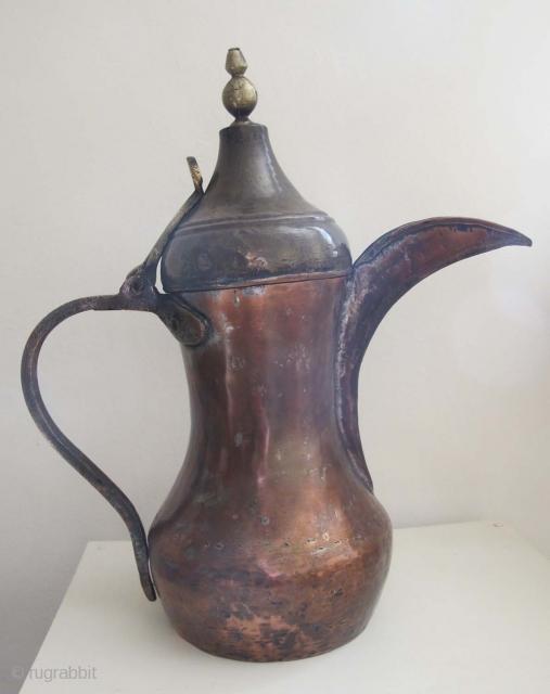 Arabian Gulf Coffee Pot (Dalla). Early 20th C. Copper & Brass. Height 35 cms