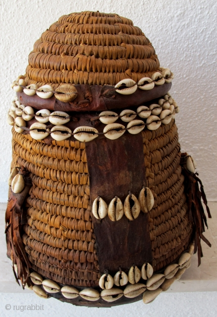 Rare Cappadocia Basket. Late 19th/early 20th c. Adorned with leather and cowrie shells. 31 x 21 cms.