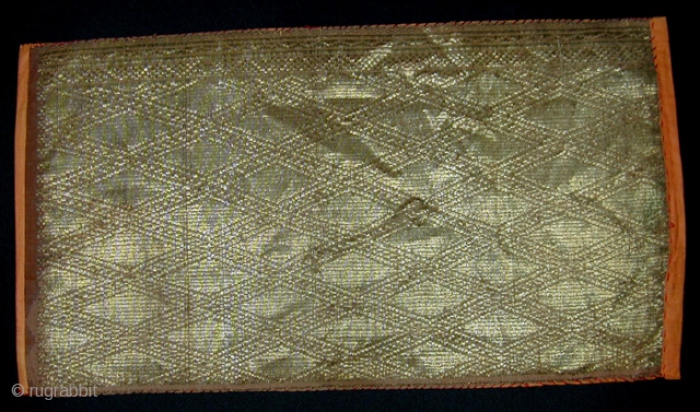 West Sumatran Gold Brocade Cloth. 19th Century. 'Kain Sandang' - part of a ceremonial headgear or shouldercloth. Minangkabau people. Gold, silk, cotton thread - supplementary weft weave. 37 x 20 cms.