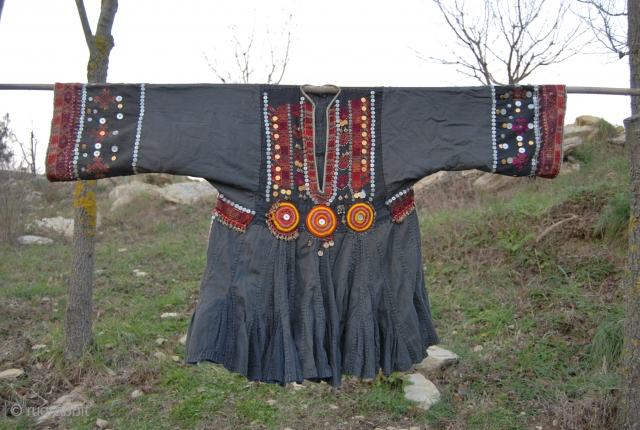 Nuristan. Jumlo or woman wedding dress from Kohistan/Nuristan, Northern Pakistan and Afghanistan. Heavily silk embroidered on black cotton, with lots of white and copper plastic buttons, metal roundels, lead beads, etc. Early  ...