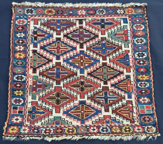 """Another intriguing sumack bag. Cm 52x56. Second half 19th c. Great sumack weave. Lovely natural dyes. Pattern with central white background and """"endless repeating stepped lozanges with small hooks and an interior  ..."""