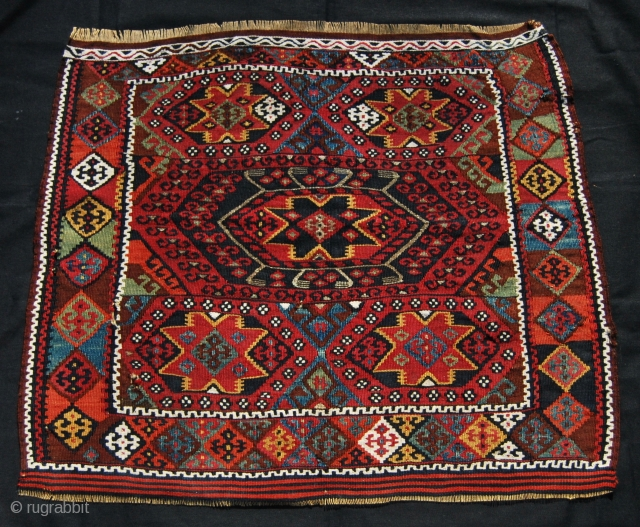Eastern Anatolia, Malatya, Porga village heybe bag face. Cm 67x79. Imo datable 1880/1890. Wool, cotton, silver/metal thread. Wonderful saturated colors, great five star pattern. Couple of small holes and tears, nothing important.  ...