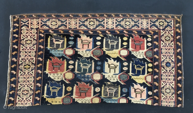 Shirwan Kuba rug fragment. Trying to save main pieces after disaster. This end one is probably the best.