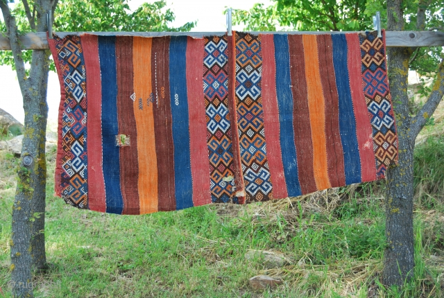 Eastern Turkey, probably Adiyaman, open cuval. A few holes & tears, but on the whole in good condition. Great colors! Good age. Size is cm 95x190.