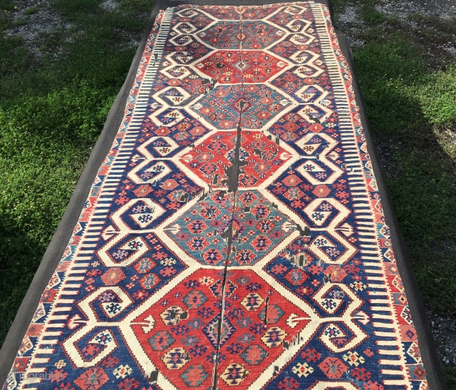 Aydin Cine kilim. Size is cm 150x360 ca. Second half 19th century. Professionally mounted on black linen. Gorgeous colors. Fantastic deep madder red, great cochineal pink, indigo blue, light yellow,, etc. Very  ...
