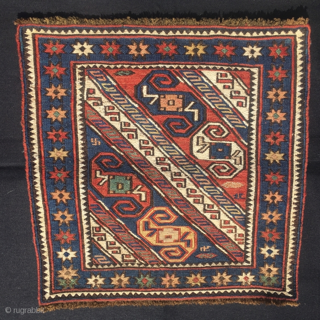 Dragons, stars, swastikas, big S good luck symbols. Sweet, rare Baku area sumack dragon bag face. Cm 42x42. End 19th, beg 20th c. Great pattern, great colors, great condition.  Not to  ...