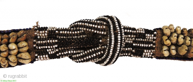Kuba people belt (mukody mu-ikup lakiing). Congo. First half 20th century. A wonderful tribal art example made of raffia, cowry shells and glass beads. 