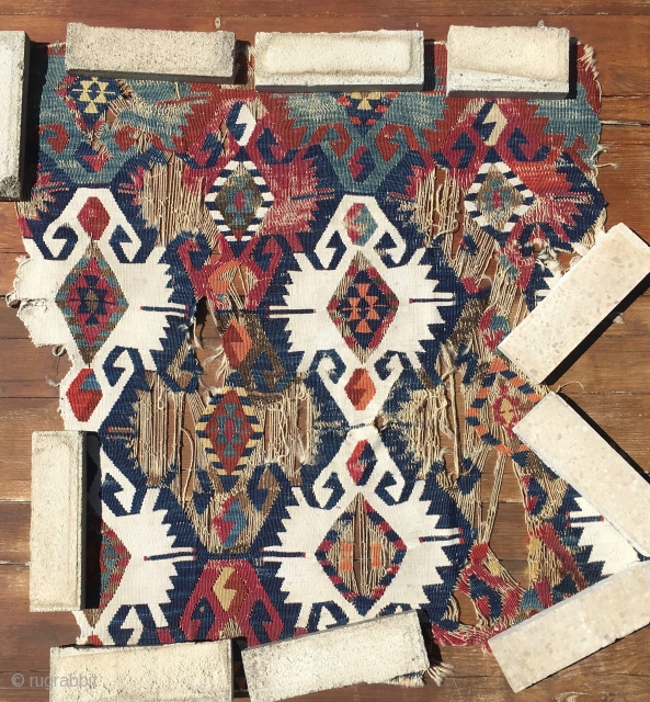 "Anatolian kilim fragment. Cm 93x93 ca. Datable mid 19th century. A ""wreck"" for collectors, museums....."