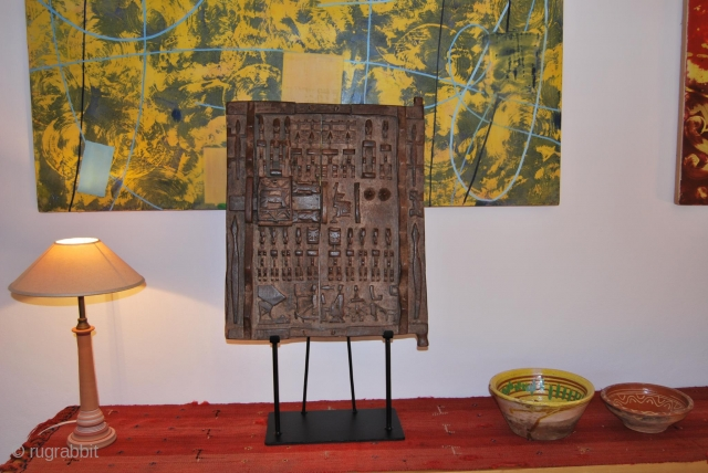 Dogon granary door. Cm 41x48 ca. without stand. Early 20th c. Lovely original wooden door in very good condition. Sold with customized iron stand. Great, museum quality tribal jewel. More infos 6  ...