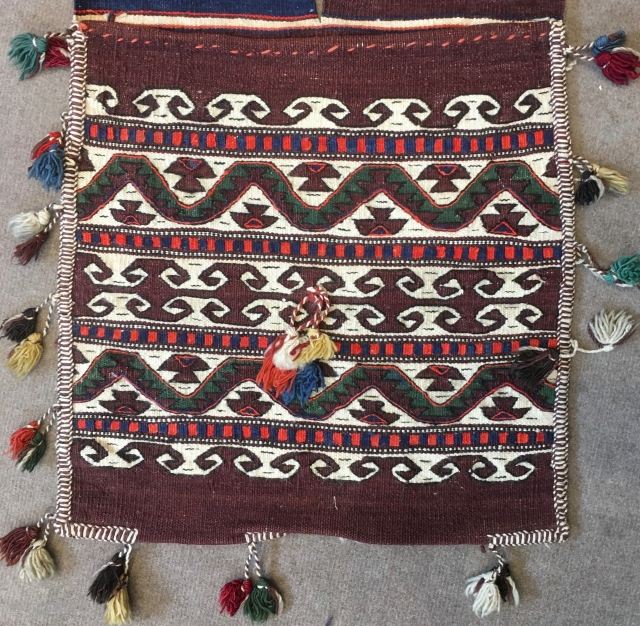 Western Anatolia. Bergama area. Bag face of a complete heybe or donkey saddle bag. Hands on hips/elibelinde, power symbols/ram horns, wishes/dileks, etc.....there is everything in this very decorative little donkey bag. See  ...