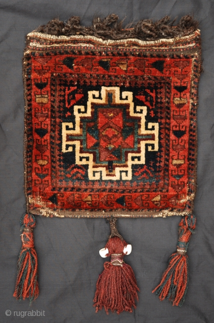 Very good Baluch pile chanteh. Great dyes, original tassels with sea shells.  Very nice flatwoven back. Good condition.