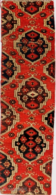 Turkmen Chodor Main Carpet fragment 118 x 32 cm 3 man figures on the edge.