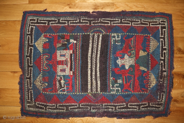 This charming piece is a tableau of Nomadic life. One side of the saddle cloth depicts a small monastery building, with a rider on horseback on the left and a Tibetan mastiff  ...