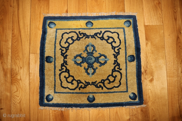 Ceremonial seating rug. Ningxia, 19th. century. One end is repaired. 23 x 26 inches.