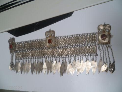 This is an authentic Kuchi triabal headress.The pendants is traditional   Turkmen design.  Overview: Vintage item Primary colour: Silver Materials: alloyed silver, fabric, seed beads, stones carneool