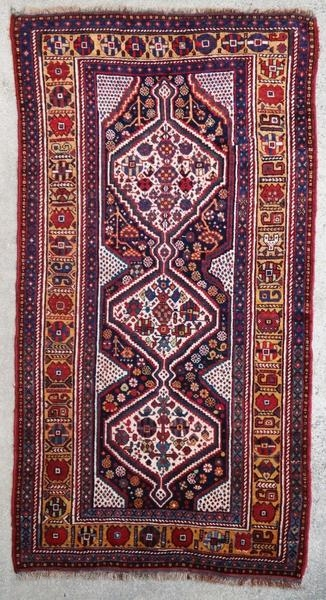 Ancient Ghashghai rug in good general condition with some slight wear. Redone selvedges.