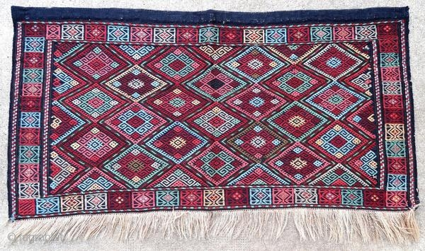 Anatolia bag face, kilim technique, embroidered in good general condition.  Origin : Turkey Period : early 20th century Size : 106 x 56 cm Material : wool on wool Good general condition Vegetable dyes Handwoven  This rug has been cleaned  ...