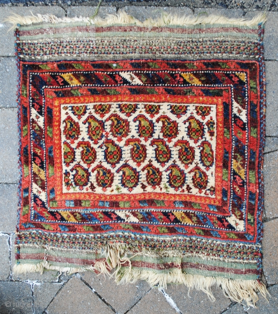 "A classic Neirez Afshar mat. There are many examples of Afshar ""sitting rugs"" but they are usually 3-3 1/2 feet square. This mat is only 2' square. so its function is a  ..."