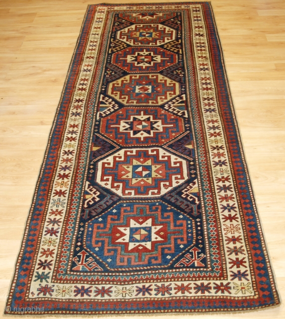 Antique Caucasian Kazak runner with Memlinc guls within octagons. www.knightsantiques.co.uk   Circa 1880.  A superb Kazak rug with a single vertical row of 'Memlinc guls'   Superb colour and typical Kazak weave  Great condition, even wear  ...